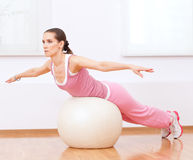 Woman doing stretching exercise on ball Royalty Free Stock Photography