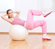 Woman doing stretching exercise on ball Stock Photography