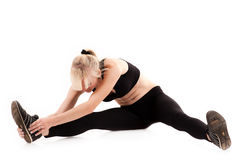 Woman doing stretching before exercise Stock Photos