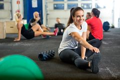 Woman Doing Stretching Exercise At Cross Training Royalty Free Stock Photos
