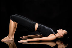 Woman doing stretching exercise on the floor Royalty Free Stock Image