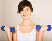 Woman doing stretching exercise at the gym Stock Photo