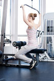 Woman doing stretching exercise at the gym Royalty Free Stock Images
