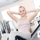 Woman doing stretching exercise at the gym Royalty Free Stock Photography