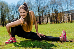 Woman doing stretching exercise outdoors Stock Photography