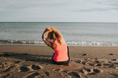 Woman doing stretching exercise at seashore. Stock Photography