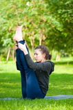 Woman doing stretching exercise. Yoga Royalty Free Stock Image