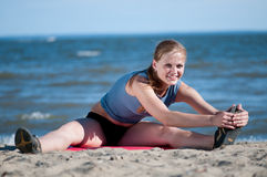 Woman doing stretching exercise. Yoga Stock Image