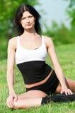 Woman doing stretching exercise. Yoga stock image