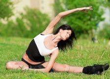 Woman doing stretching exercise. Yoga stock photo