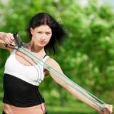 Woman doing stretching exercise. Yoga Stock Photos