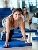 Woman doing stretching exercises Stock Images