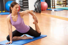 Woman Doing Stretching Exercises Stock Photos