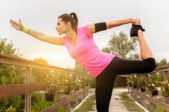 Woman doing stretching exercises. Stock Photos