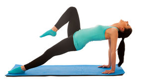 Woman doing stretching exercises on blue mat isolated over white stock photos