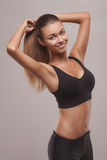 Woman doing stretching exercises Royalty Free Stock Photos