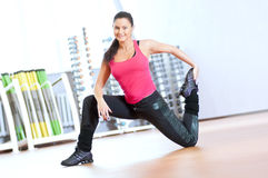 Woman doing stretching exercises at the gym Stock Image
