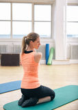 Woman doing stretching exercises at gym Royalty Free Stock Photos
