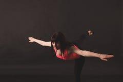 Woman doing stretching exercises Stock Photos