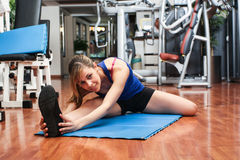 Woman doing stretching in a fitness club Royalty Free Stock Image