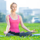 Woman doing stretching fitness exercise Yoga. lotus Royalty Free Stock Photo