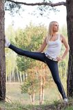Woman doing stretching in the park Royalty Free Stock Photo