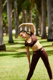 Woman Doing Stretching Before Sport Training At Morning-4 Stock Photography