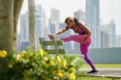 Woman Doing Stretching Before Sports Training At Morning Royalty Free Stock Photos