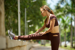 Woman Doing Stretching Before Sports Training At Morning-3 Royalty Free Stock Photography