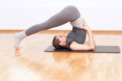 Woman doing stretching yoga exercise at sport gym Royalty Free Stock Photos