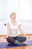 Woman doing stretching yoga exercise at sport gym Royalty Free Stock Images