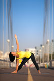 Woman doing stretching yoga exercises outdoors Royalty Free Stock Images