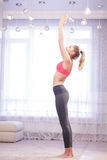 Woman doing sun salutation yoga pose Royalty Free Stock Photography