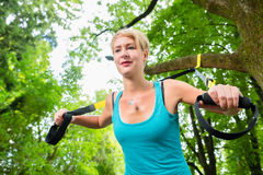 Woman doing suspension sling trainer sport Stock Photo