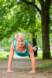 Woman doing suspension sling trainer sport Royalty Free Stock Images
