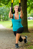 Woman doing suspension sling trainer sport Royalty Free Stock Photography