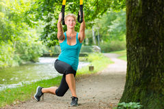 Woman doing suspension sling trainer sport Stock Images