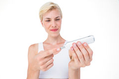 Woman doing test with blood glucose monitor Stock Photography
