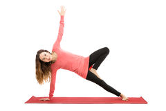 Woman doing tree pose variation Stock Images