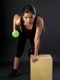 Woman doing tricep extensions Royalty Free Stock Image