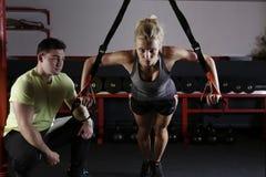 Woman doing TRX training Royalty Free Stock Image
