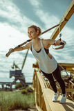 Woman doing upper body exercise training arms using trx suspension Stock Images