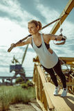 Woman doing upper body exercise training arms using trx suspension Royalty Free Stock Photo