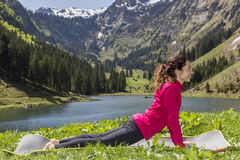 Woman doing upward facing dog outdoors Stock Images