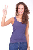 Woman doing victory sign Stock Photos