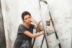 Woman doing wall painting Royalty Free Stock Photos