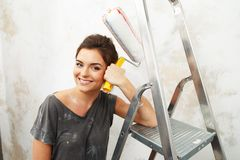 Woman doing wall painting Royalty Free Stock Images