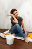 Woman doing wall painting Stock Photos