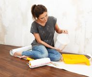Woman doing wall painting Stock Images