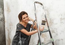 Woman doing wall painting royalty free stock image
